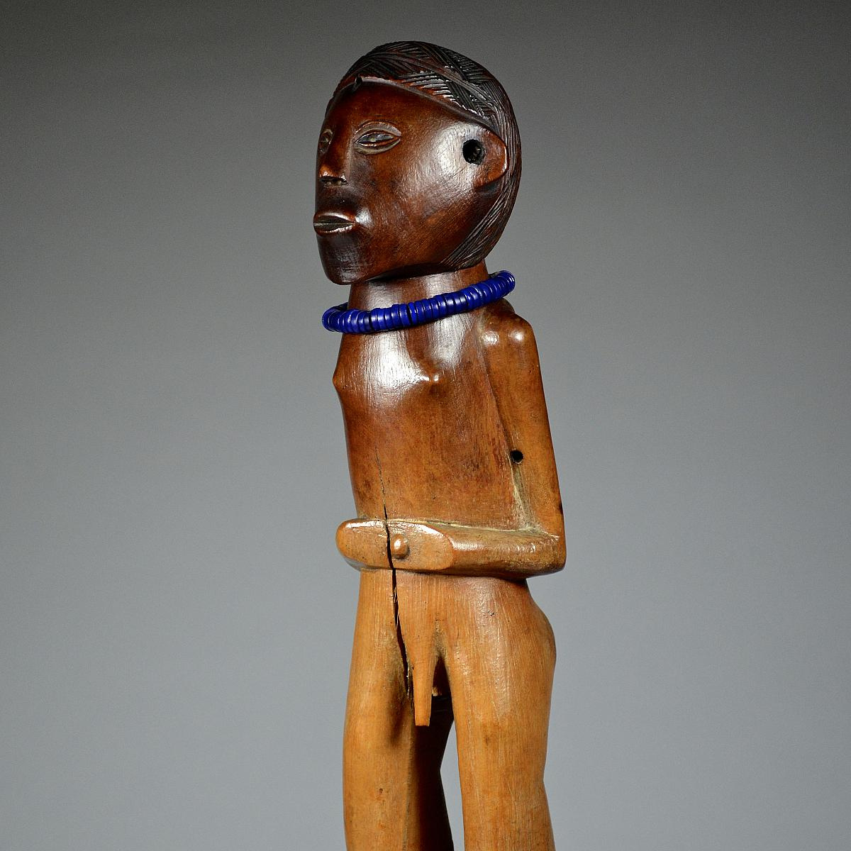 MALE STATUETTE ATTRIBUTED TO THE TABWA (Tumbwe)